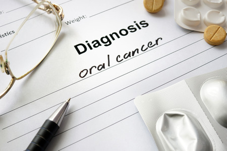 oral cancer: Diagnosis oral cancer written in the diagnostic form and pills.