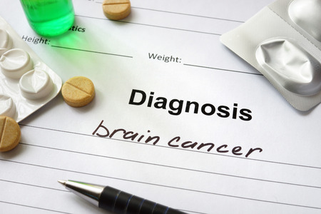 abnormal cells: Diagnosis brain cancer written in the diagnostic form and pills.