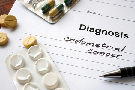 endometrial: Diagnosis  endometrial cancer written in the diagnostic form and pills.