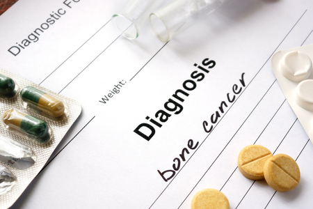 malignancy: Diagnosis bone cancer written in the diagnostic form and pills. Stock Photo