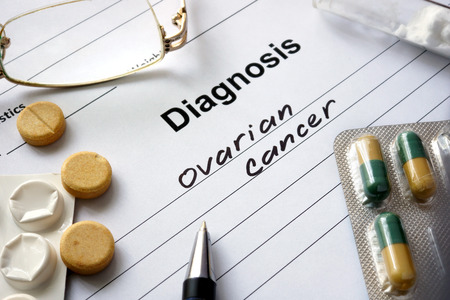 abnormal cells: Diagnosis ovarian cancer written in the diagnostic form and pills. Stock Photo
