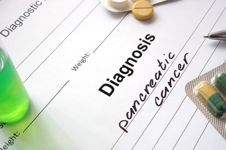 malignancy: Diagnosis pancreatic cancer written in the diagnostic form and pills.
