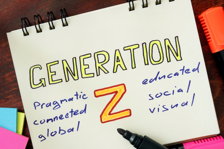 generation: Notepad with generation z on the wooden table.