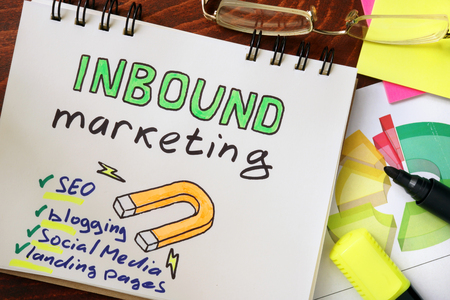 inbound: Notepad with inbound marketing on the wooden table. Stock Photo