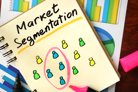 segmentation: Notepad with market segmentation. Selected segment of customers concept.