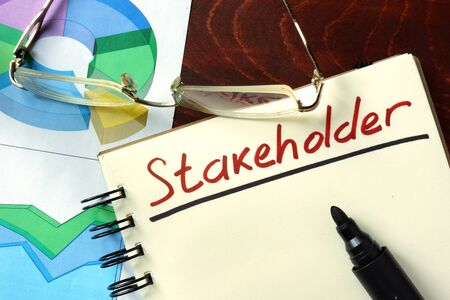 stakeholders: Stakeholder  concept. Notepad on the table. Stock Photo