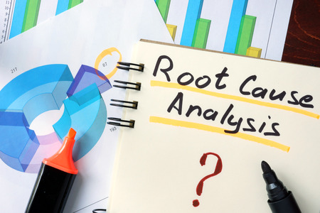root: RCA - Root Cause Analysis  concept. Notepad on the table.