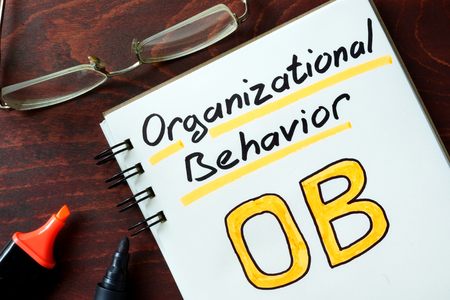 instance: Organizational behavior  concept. Notepad on the table. Stock Photo