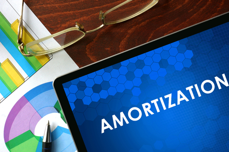amortization: Tablet with amortization on a table. Business concept. Stock Photo