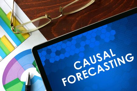 causal: Tablet with causal forecasting on a table. Business concept. Stock Photo