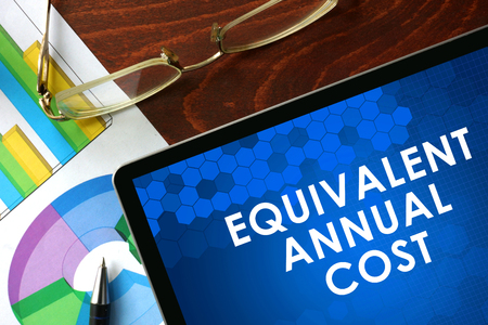 equivalent: Tablet with equivalent annual cost on a table. Business concept. Stock Photo