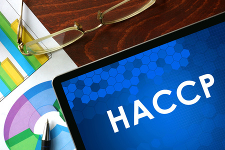 Tablet with  HACCP on a table. Business concept. Stock Photo