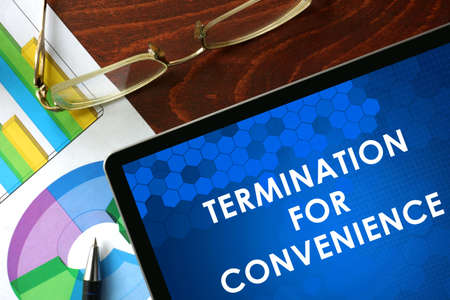 termination: Tablet with termination for convenience on a table. Business concept.