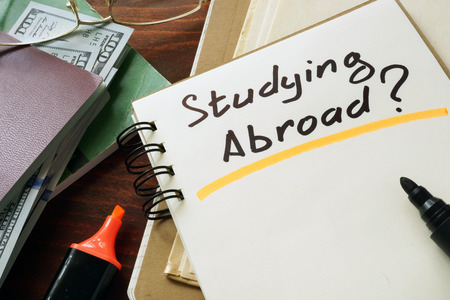 Notepad with Studying Abroad on a table.