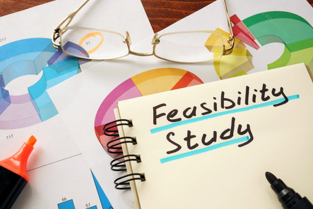 feasibility: Notepad with  feasibility study on a table.