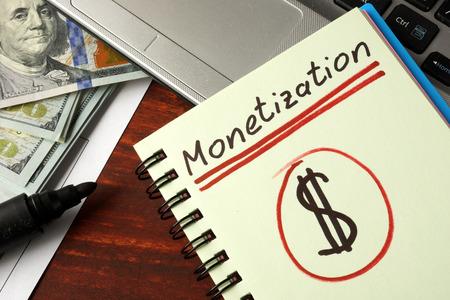 monetization: Notebook with monetization  sign.  Business concept.