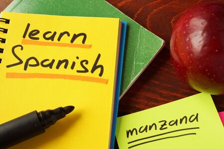 distance learning: Notebook with learn Spanish  sign. Education concept.