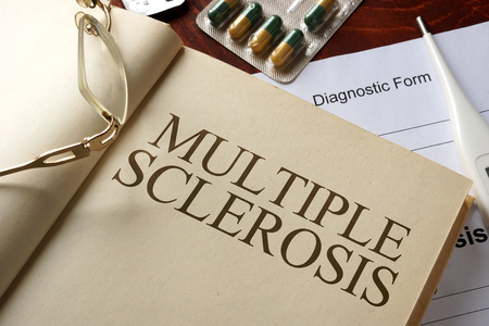 multiple: Book with diagnosis multiple sclerosis. Medic concept.