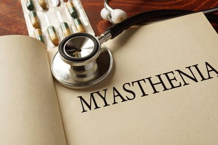 ailing: Book with diagnosis  myasthenia. Medic concept.