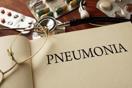 pneumonia: Book with diagnosis Pneumonia. Medic concept.