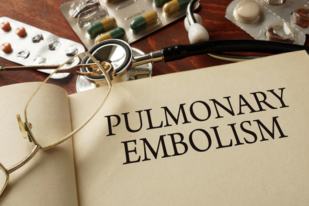 embolism: Book with diagnosis Pulmonary embolism PE. Medic concept.