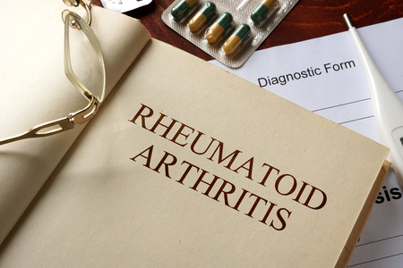 Book with diagnosis  rheumatoid arthritis. Medic concept.