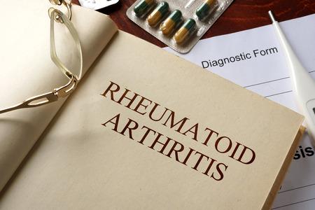 Book with diagnosis  rheumatoid arthritis. Medic concept.