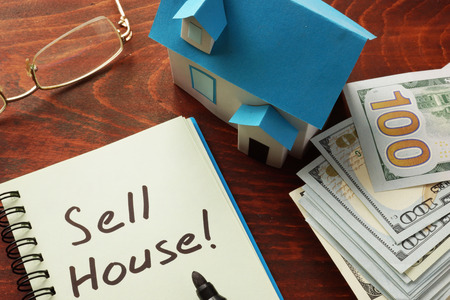sell house: Notebook with the words  Sell house on the table. Stock Photo