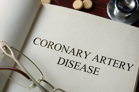 sudden: Book with diagnosis   coronary artery disease. Medical concept.