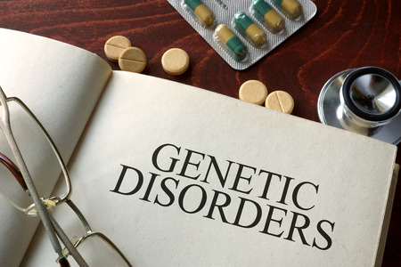 eradicate: Book with diagnosis   genetic disorders. Medical concept.