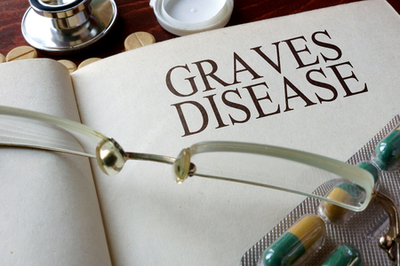 hypothyroidism: Book with diagnosis Graves disease. Medical concept.