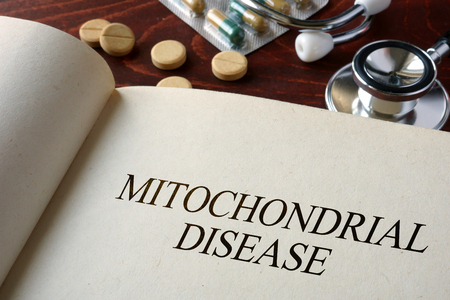 unaffected: Book with diagnosis   mitochondrial disease. Medical concept.