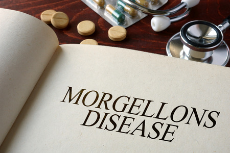 ailing: Book with diagnosis Morgellons disease. Medical concept. Stock Photo