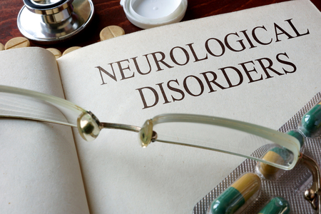 neurological: Book with diagnosis neurological disorders. Medical concept. Stock Photo