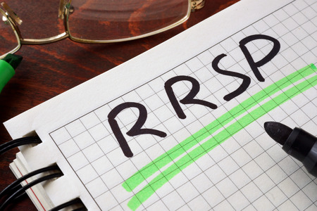 money savings: Notebook with  RRSP sign on a table. Business concept.