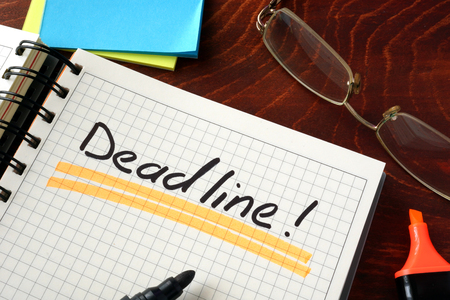 Notebook with Deadline  sign on a table. Business concept. Stock Photo
