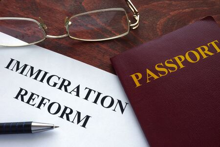 immigrate: Paper with immigration reform on a table. Stock Photo