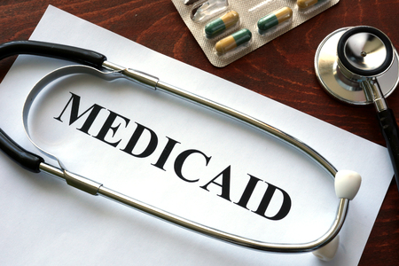 Paper with Medicaid and stethoscope. Medical insurance concept.