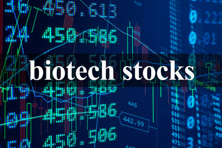 Words Biotech stocks with the financial data on the background.