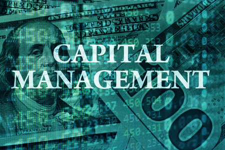 capital: Words Capital management  with the financial data on the background.