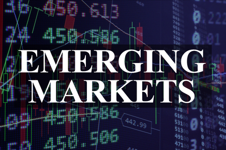 emerging markets: Words emerging markets  with the financial data on the background.