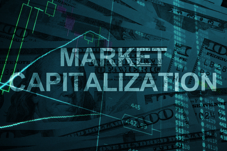capitalization: Words Market capitalization  with the financial data on the background.