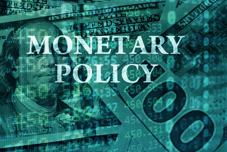 foreign policy: Words Monetary policy  with the financial data on the background.