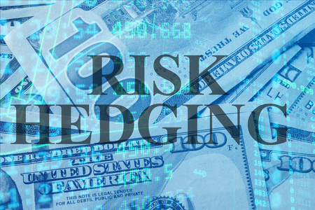 hedging: Words  Risk hedging  with the financial data on the background.