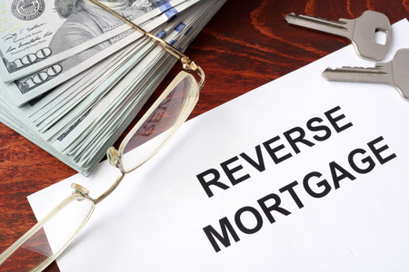 reverse: Reverse mortgage form on a table and money.