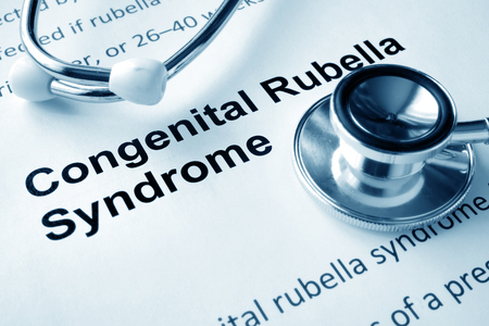 congenital: Paper with words  Congenital Rubella Syndrome  and stethoscope. Stock Photo
