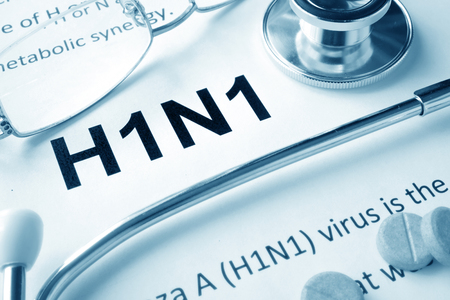 swine flu vaccination: Paper with word   H1N1 disease and stethoscope.