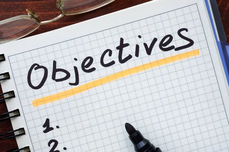 objectives: Objectives concept  written in a notebook Stock Photo