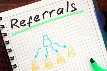 referrals: Referrals concept  written in a notebook Stock Photo