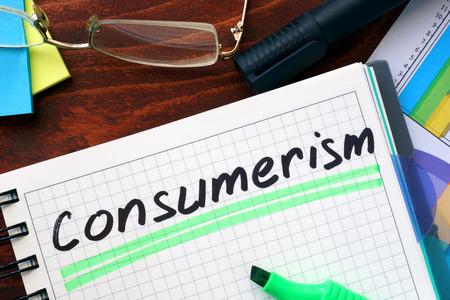 consumerism: Consumerism concept  written in a notebook